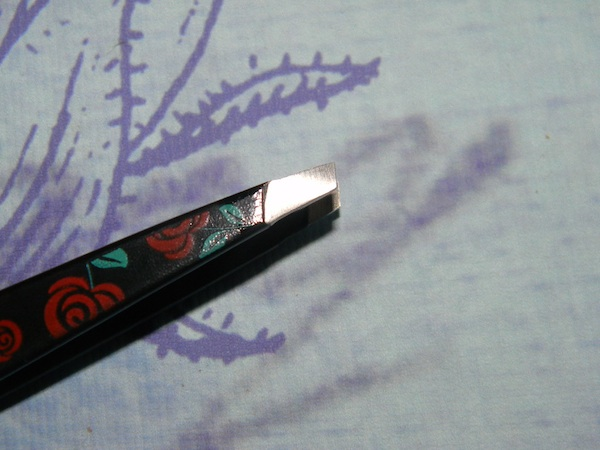 Tweezerman rose tweezer close up.